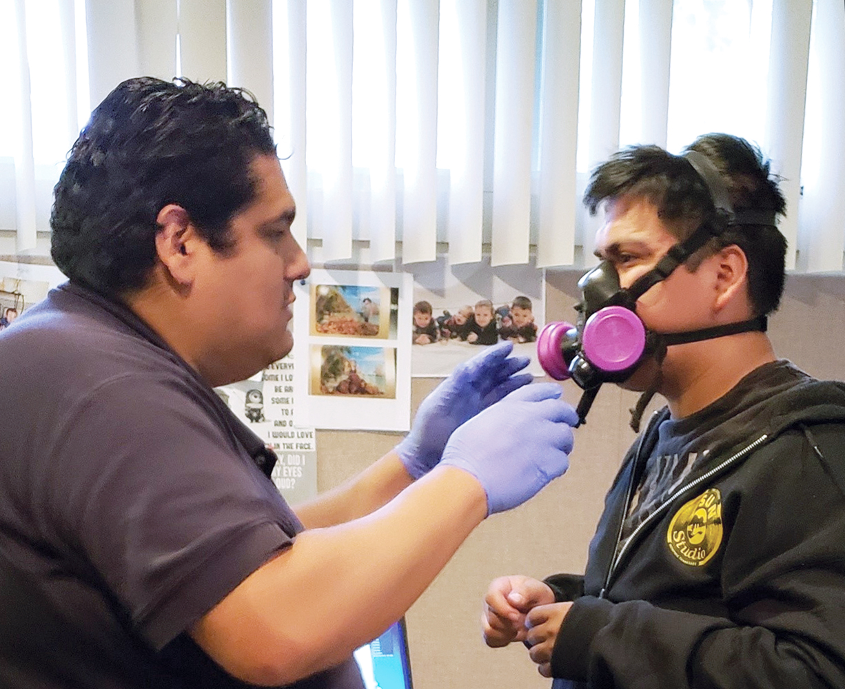 Photo of professional test fitting breathing mask.