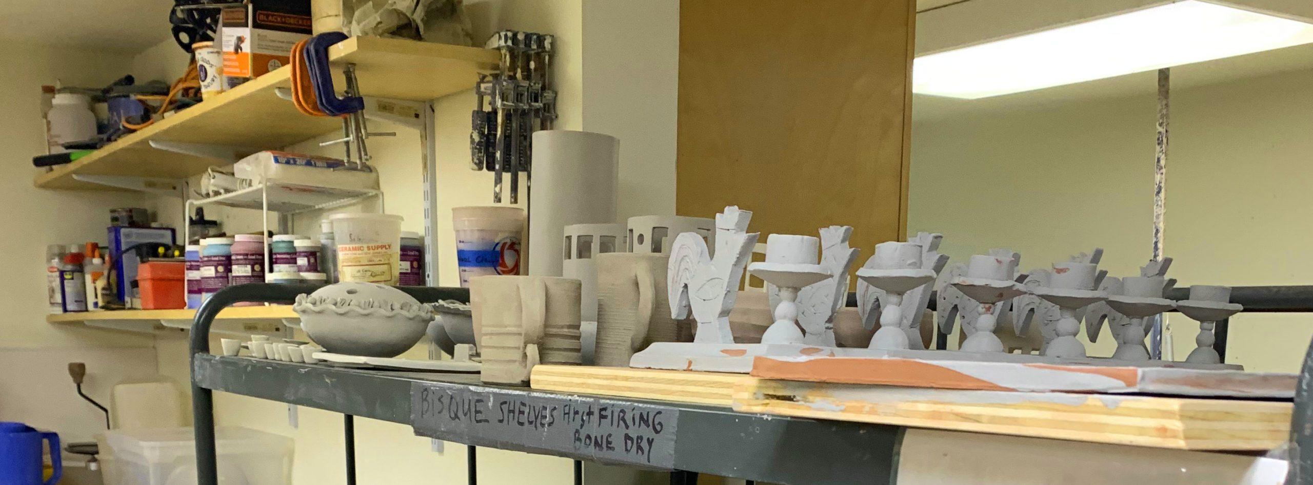 Ceramics shown on shelves in an art studio